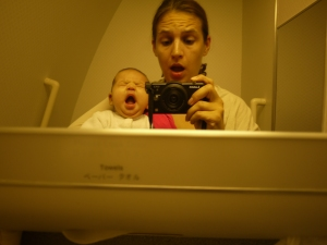 Baby yawning airplane bathroom
